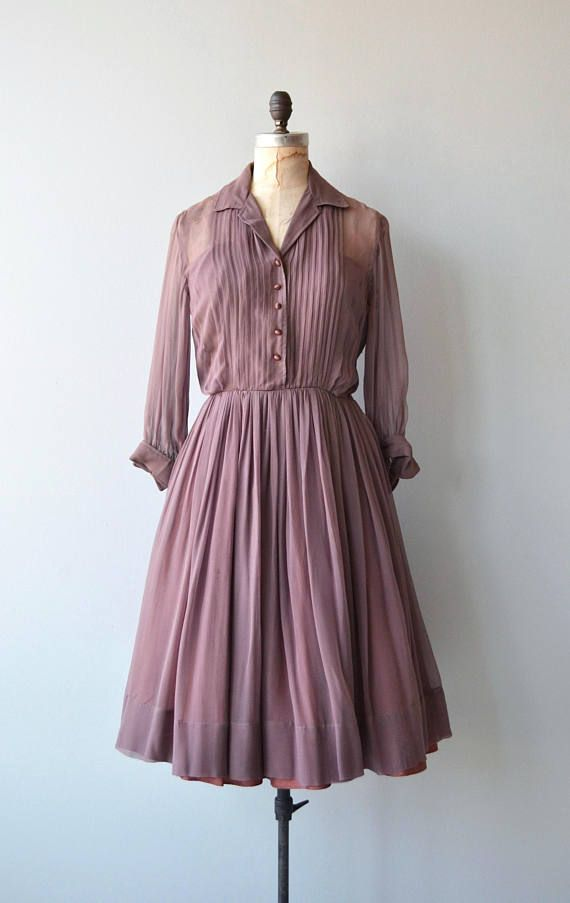 Vintage 1950s dusky mauve silk chiffon shirt dress with partial sheer bodice, fitted waist, long cuffed sleeves, full unpressed pleated skirt and metal side zipper. --- M E A S U R E M E N T S ---  fits like: small bust: 35-38 waist: 27 hip: free length: 41 brand/maker: n/a condition: excellent  to ensure a good fit, please read the sizing guide: http://www.etsy.com/shop/DearGolden/policy  ✩ layaway is available for this item  ✩ more vintage dresses ✩ http:&...