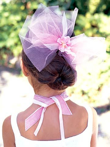 Use tulle fabric or wide ribbon to create a hair ornament for your flower girl.