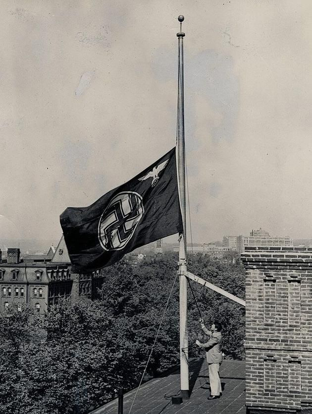 German flag at half mast after the Hindenburg accident in Washington,1937