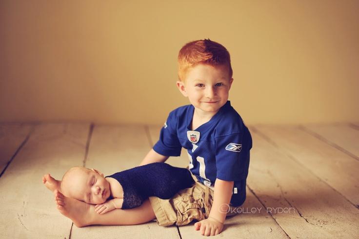 newborn sibling photo
