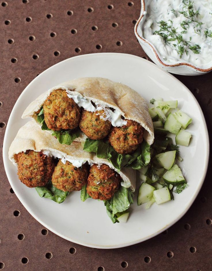 "Homemade Falafel + Cucumber Dressing by A Beautiful Mess. The last time I made falafel was for a family dinner night. My dad kept calling them ""matzo balls"" which I thought was funny. Falafel is a little bit time consuming but SOOOO worth the effort. This is a great recipe to impress your significant other or your next dinner party guests—if they like food that's awesome."
