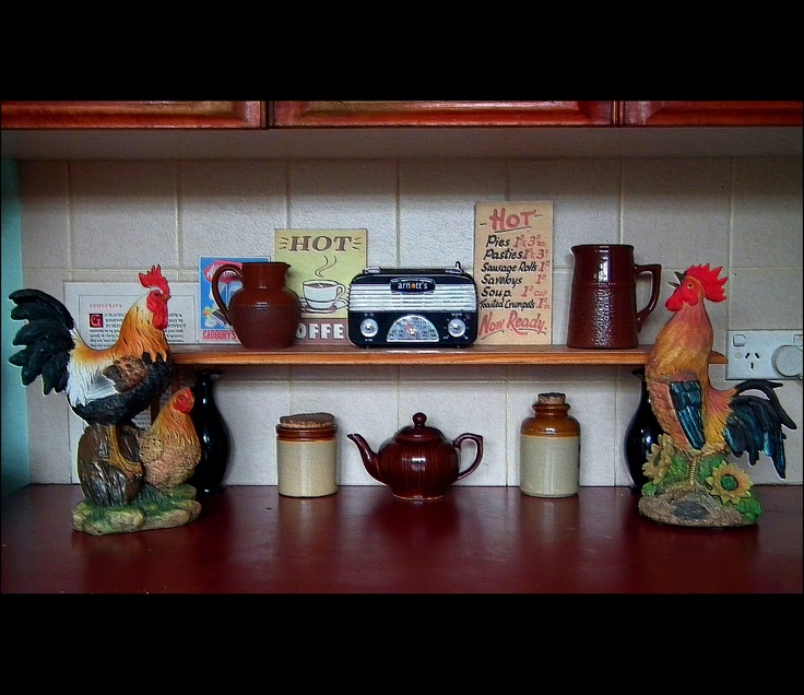The roosters visiting the kitchen bench.