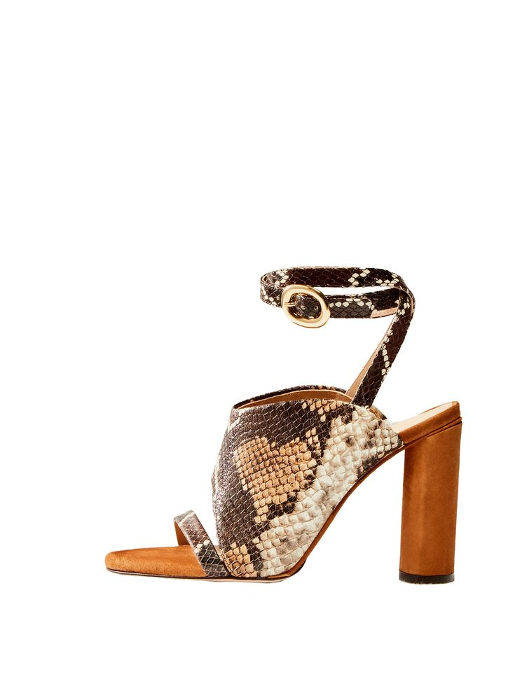 High heel sandals made of animal print embossed leather. They feature ankle straps in the same material as the upper, heels lined in tan-coloured suede leather, leather lining and insoles and natural leather soles. Part of the Limited Edition Collection.