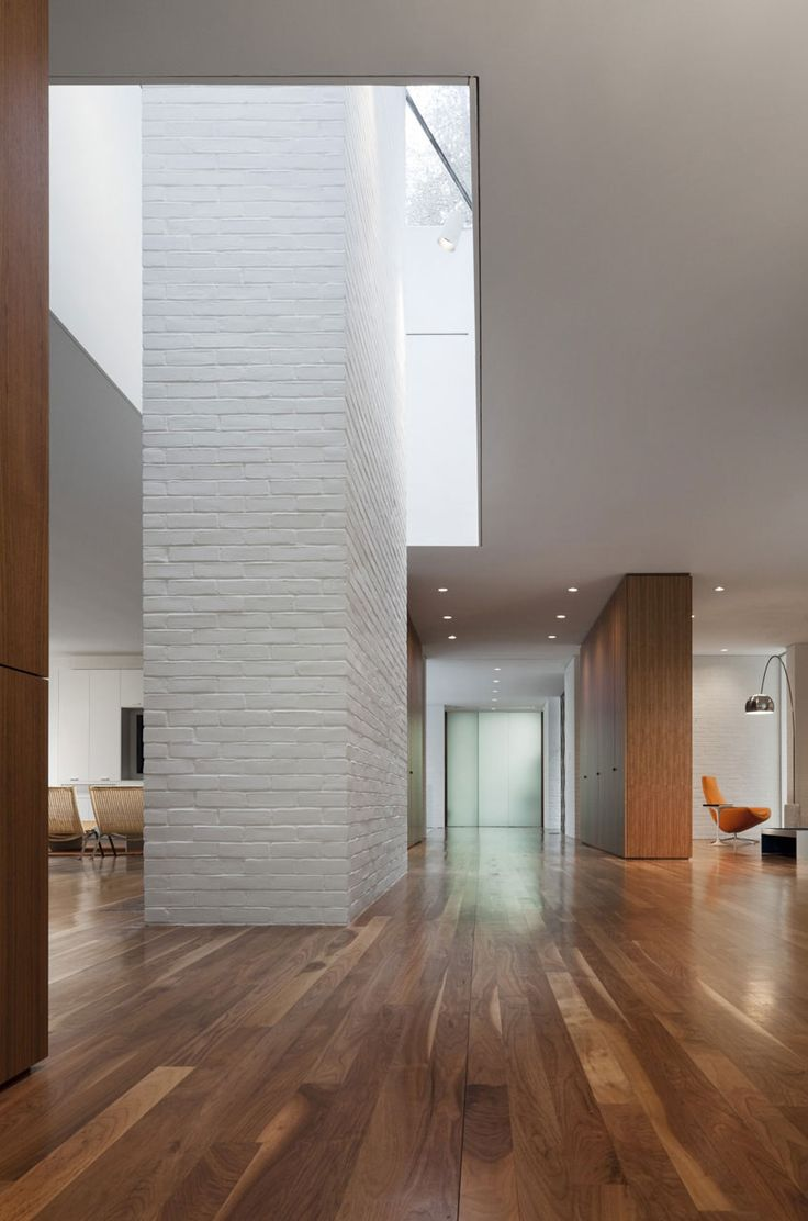 Brick chinmey inside the Record House Revisited by David Jameson Architect.: Living Spaces, Open Spaces, Brick Wall, Brick Fireplaces, Wood Floors, David Jameson, High Ceilings, Records Houses, White Brick