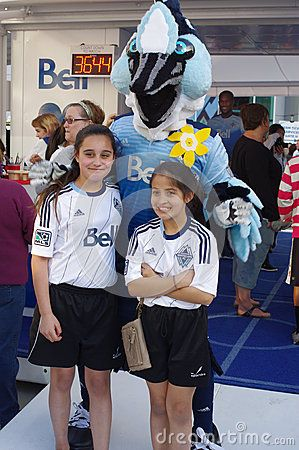 Vancouver Whitecaps mascot with young supporters in front of BC Stadium.