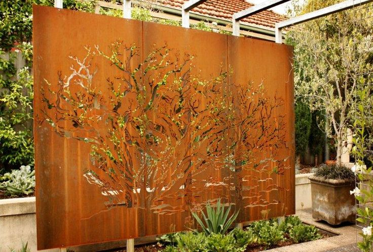 Using metal in the landscape for garden walls, screens or house numbers  is a great way to add some garden art and sculptural function to the essential but usually dull components of the garden.