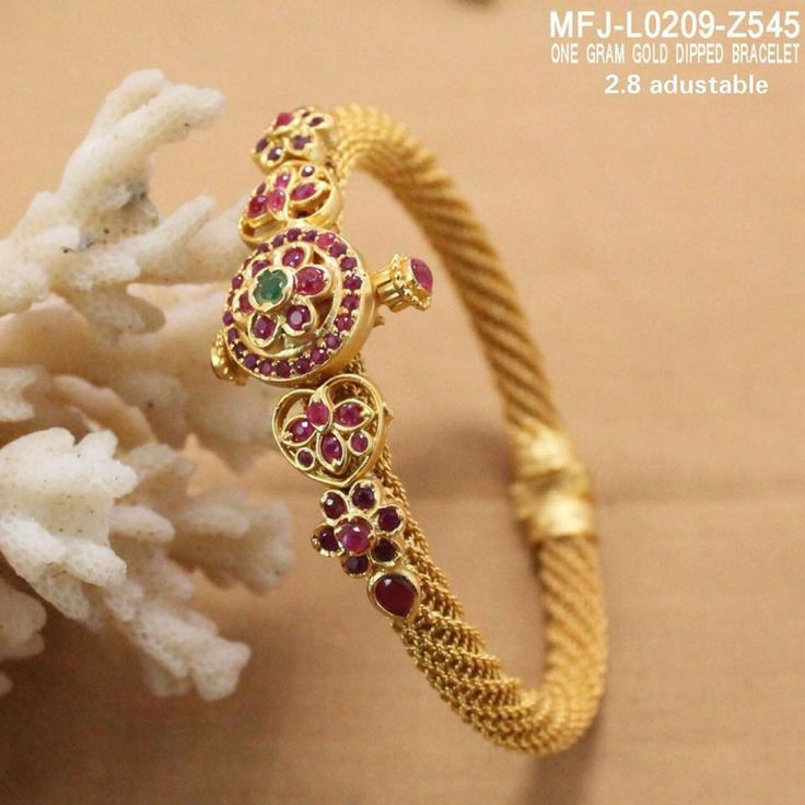Rs 1250 . Beautiful one gram gold dialy wear bangle with screw back. Bangle studded with pink color stones. 17 November 2017