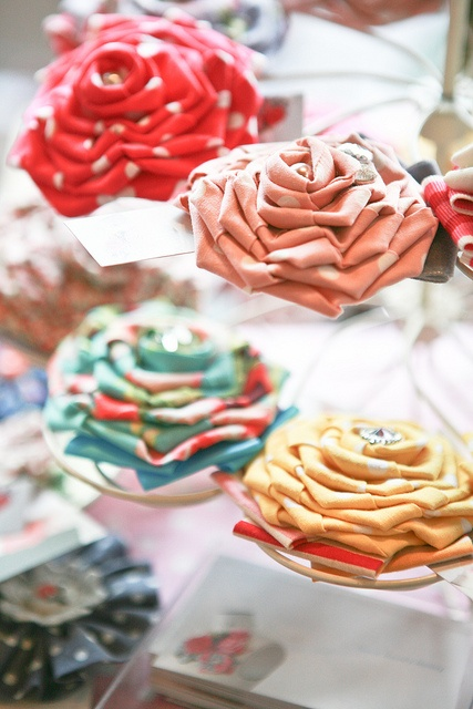 We adore this colourful lower corsages... Make them from an array of fabrics for a swoon-worthy bouquet.
