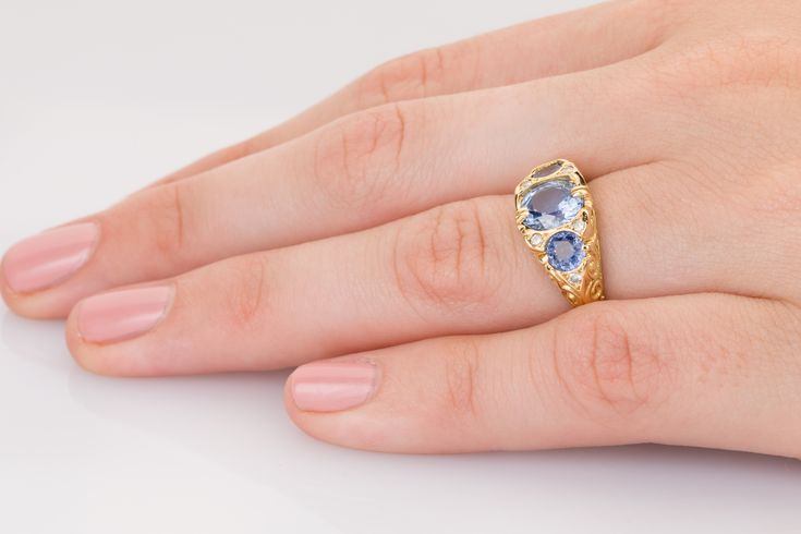 Pretty blue/lilac sapphires and sparkling diamonds in 18k yellow gold. Divine.
