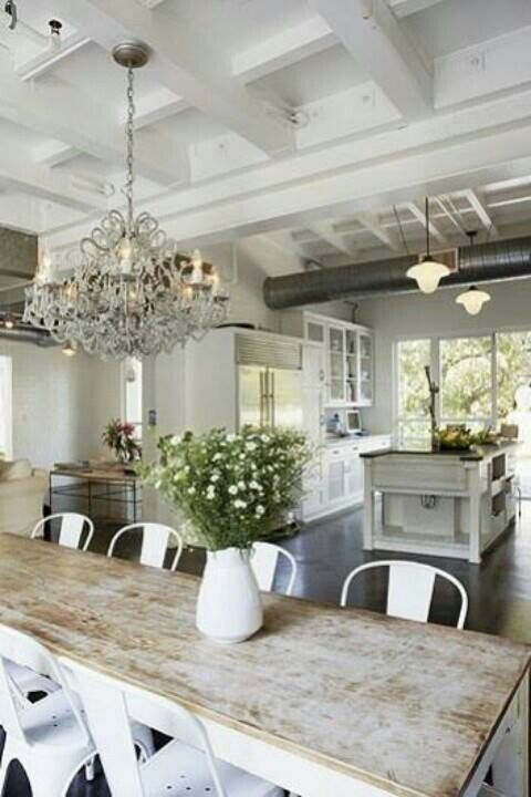 this is the feel i want in my new house. Love the mix of worn wood, metal, and a touch of over the top with the chandelier. It's me!