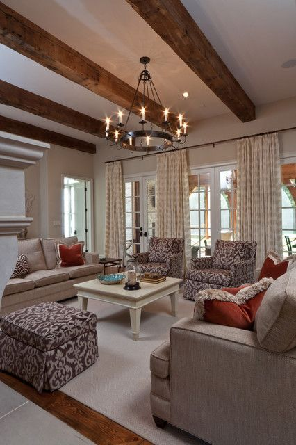 Fabulous living space. Love the tan and white curtains, love the beams, love the set up!