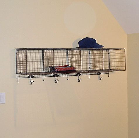 Metal Wire Wall Shelf from Hudson Goods.   This vintage metal wire shelf accessorized with old leather footballs, books, helmet and hanging football pennants is perfect in my son's bedroom.