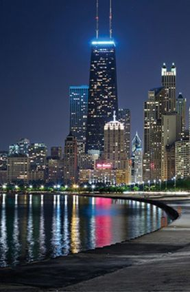 Chicago skyline from the shores of Lake Michigan, at night