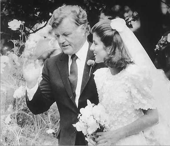 Senator Edward M. Kennedy walked his late brother, President John F. Kennedy's daughter, Caroline, down the aisle when she married Edwin Schlossberg on July 19, 1986. The wedding took place at Our Lady of Victory Catholic Church in Centerville, Massachusetts followed by a reception at the home of her grandmother, Rose Kennedy.