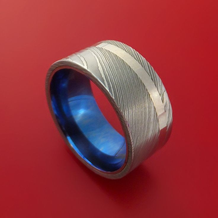 Damascus Steel Wide Ring with Palladium Inlay and Anodized Titanium Sleeve Wedding Band Custom Made by StonebrookJewelry on Etsy https://www.etsy.com/listing/264409257/damascus-steel-wide-ring-with-palladium