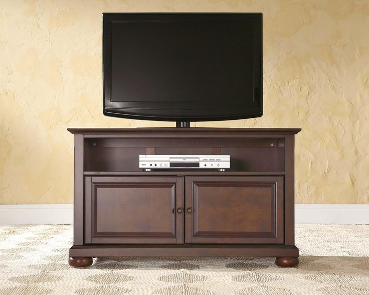 Crosley Furniture Alexandria 42-Inch TV Stand, Vintage Mahogany. Accomodates most 44-inch TV's. Solid hardwood and veneer construction. Hand rubbed, multi-step finish. Beautiful raised panel doors. Antique brass finish hardware.