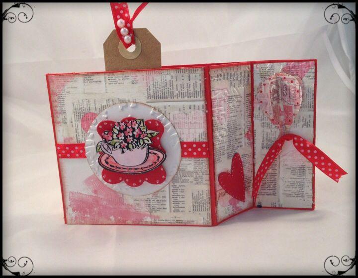 Una card in rosso..con una decorazione di fiori!