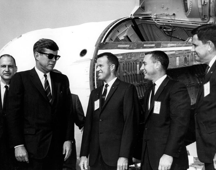 """16 November 1963, President John F. Kennedy speaks with George Low, NASA's chief of manned spaceflight; Mercury astronauts Gordon Cooper and Gus Grissom; and G. Merritt Preston,..."