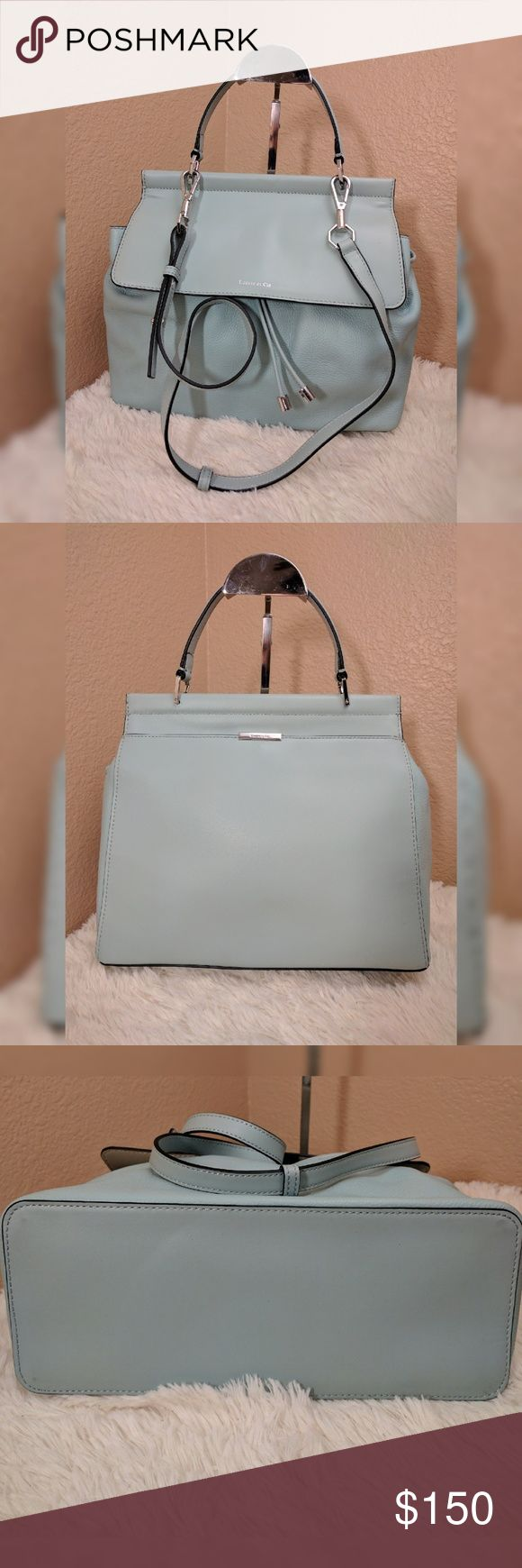 """Louise Et Cie Camuto Towa Brief Satchel 12""""W x 9 ?""""H x 5""""D. (Interior capacity: medium.)  4 ?"""" strap drop; 19"""" shoulder strap drop.  1.5 lbs.  A smooth leather flap contrasts with the pebbled texture of a clean-lined, spacious satchel that channels modern minimalism while providing season-spanning versatility.  Drawstring closure with magnetic flap.  Top carry handle; optional, adjustable crossbody strap.  Exterior slip pocket.  Interior zip pocket.  Logo-jacquard lining.  Leather.  By…"""