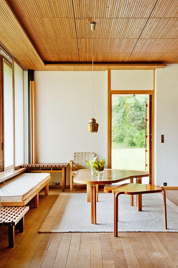 Maison Louis Carr, Alvar Aalto -- Midcentury furniture in sleek glossy blonde wood with minimal monochromatic styling. Retro and modern dining nook!