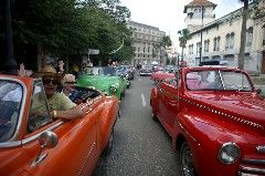 HAVANA (Reuters) - Cuba's tourism industry is under unprecedented strain and struggling to meet demand with record numbers of visitors arriving a year after detente with the United States renewed interest in the Caribbean island.Its tropical weather, rich musical traditions, famed cigars and classic
