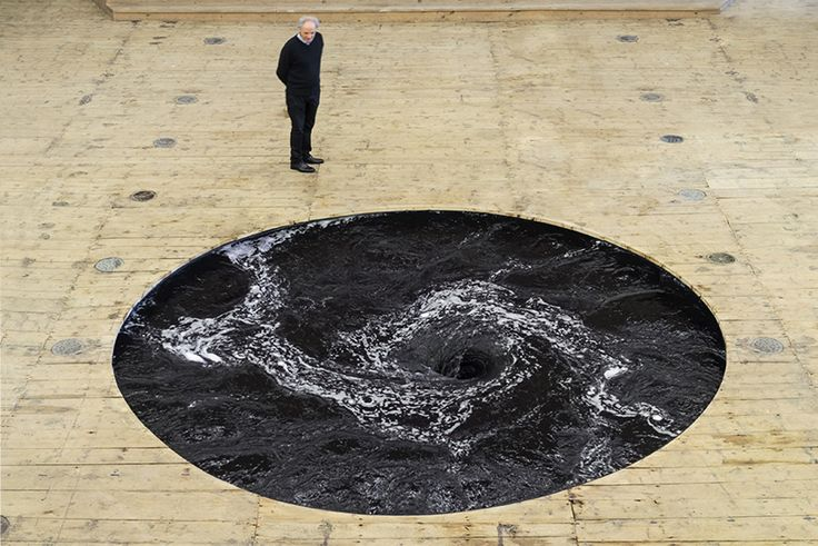 the spiraling whirlpool is treated with an all-natural black dye, creating a seemingly endless hole, into which visitors are invited to carefully peer.
