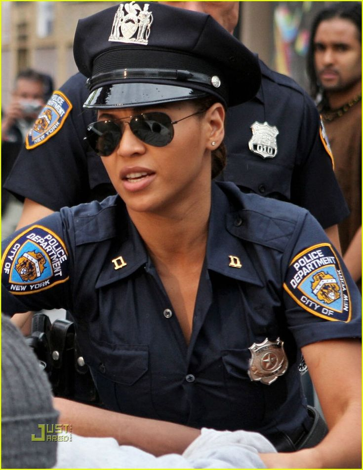 This Is A Picture Of Beyonce In A Cop Costume For Her