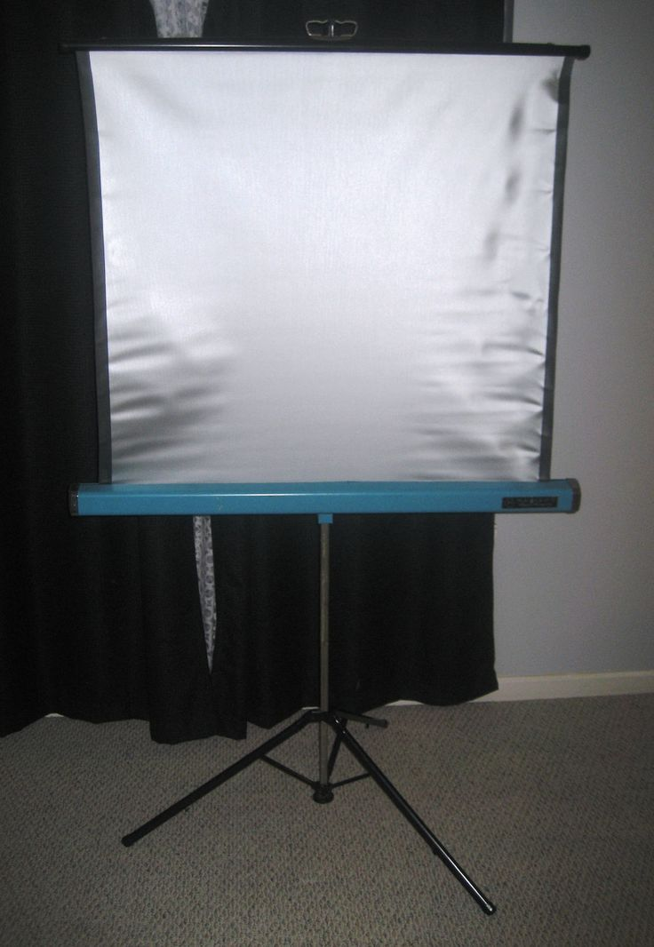 Vintage Radiant Super Champion Roll Up Projector Screen.