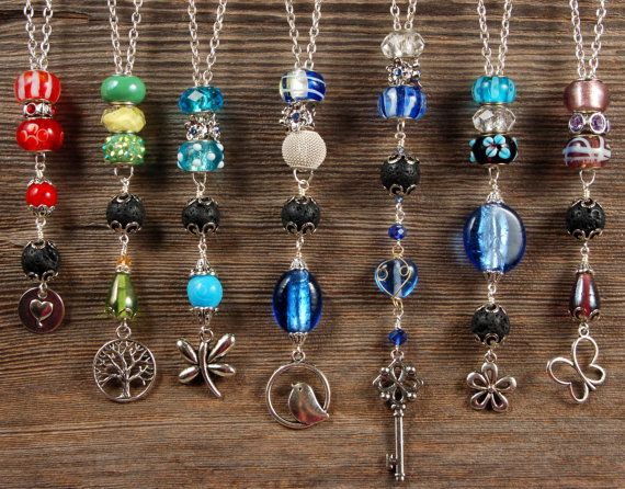 Vintage Charm Necklaces with Lava Stone. by SilverChaseDesigns