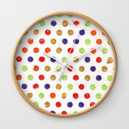 Dotty Stories by Bestree Art Designs, $30. https://society6.com/product/dotty-stories-g9l_wall-clock#s6-4732164p33a33v284a34v286