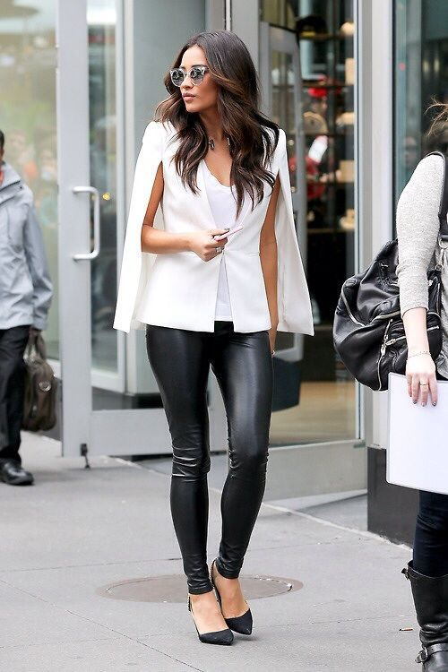Shop this look on Lookastic:  http://lookastic.com/women/looks/cape-coat-tank-skinny-pants-pumps-sunglasses/5549  — White Cape Coat  — White Tank  — Black Leather Skinny Pants  — Black Suede Pumps  — Grey Sunglasses