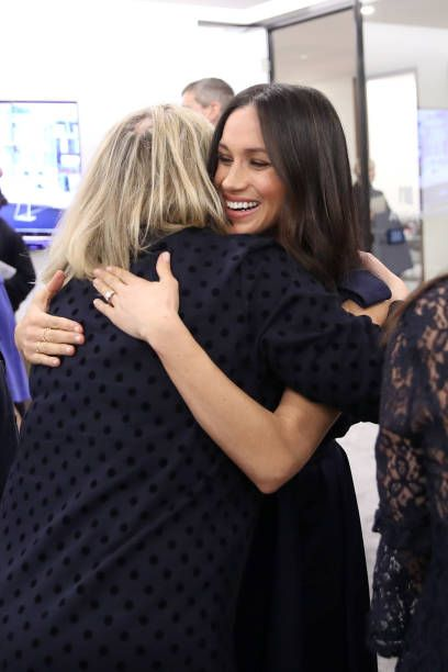 Meghan Markle fiancee to Britain's Prince Harry hugs journalist Bryony Gordon as she meets panelists and beneficiaries during the first annual Royal...