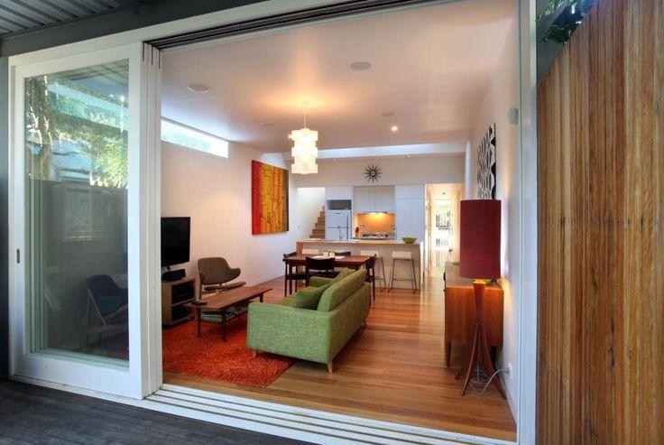 Stacked sliding doors | white frame | wooden floor