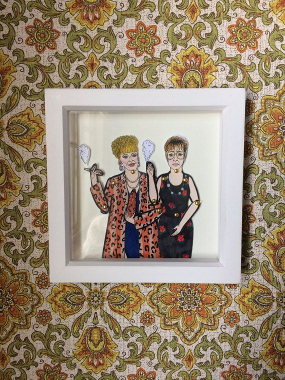 Bet Lynch and Deidre Barlow framed dolls! These beautiful little dolls are hand illustrated by myself, hand cut and pinned using mini gold brad pins then framed.  The frames come in a lovely little package that can be personalized all you have to do is message me with who the gift is TO: and FROM: and I can pop that on ready for gifting.  All dolls are roughly 25cm tall and are professionally printed on sturdy 300gsm matt card before being hand cut and pinned. All framed doll sets come in a…