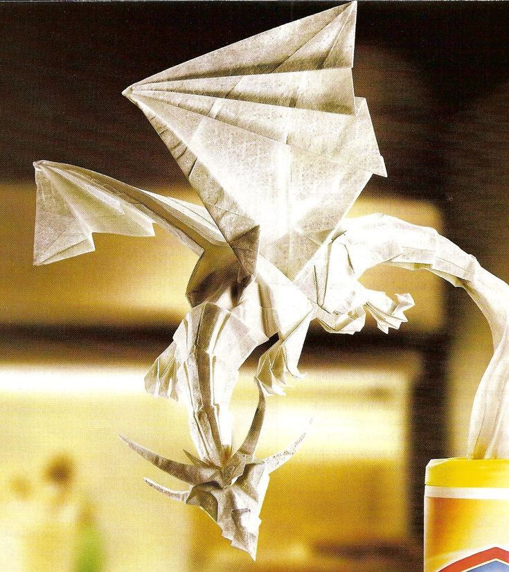 This Origami dragon is just like the one I had in a dream, but the one in my dream was red and it turned into a living breathing dragon when I threw it into the air. :) My flying protector.