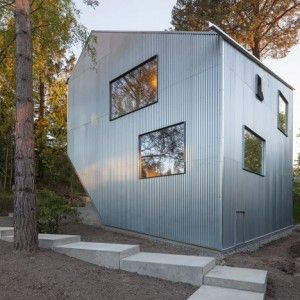 Happy Cheap house by Tommy Carlsson  is a prototype for low-cost prefab homes - Love the simplicity and use of wood as well as the overall shape