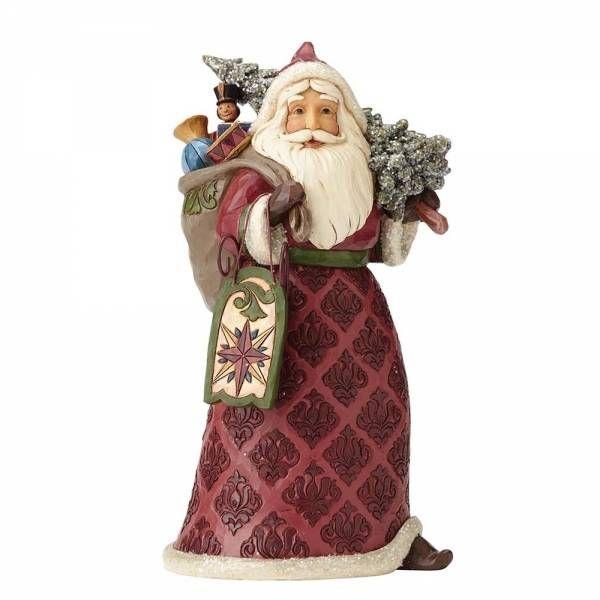 Deze victoriaanse kerstman met slee van Jim Shore is gedecoreerd met een retro uitstraling. Hoogte: 24 cm.