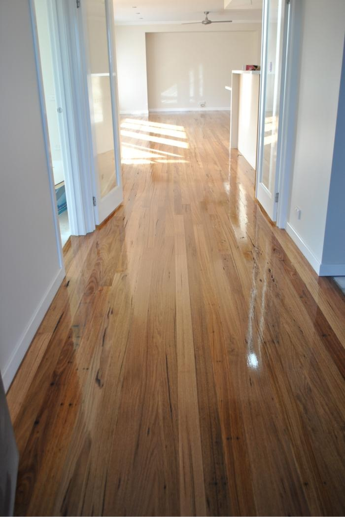 Wormy Chestnut Flooring - full of variation and sap/markings give a rustic feel in an otherwise stark home .. ?