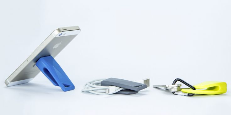 Stikey - a magnetic stand and cable tidy on your keys! April on Kickstarter! http://stikey.co.uk/