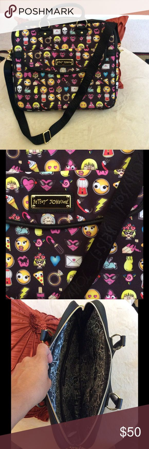 Betsey Johnson Laptop Travel Bag Black/Multi colors, emojis laptop travel case/bag. Outside snap button pocket, inside cell phone pockets, and zipper pocket. Padded for laptop protection. NWOT. My laptop is 15in wide, 17.5in diagonal and fits in this bag. Price is firm at this time, unless bundled Betsey Johnson Bags Laptop Bags