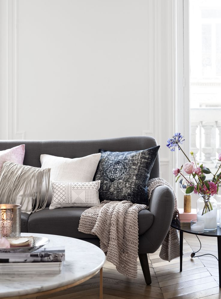 Charcoal sofa with different colours to compliment the grey.