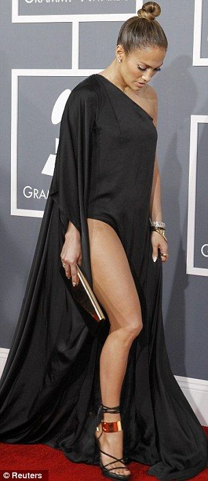 Doing an Angelina: Jennifer Lopez posed much like Jolie as she showed off her leg through her floor length black gown