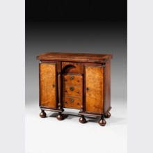 Bachelors Chest  A rare Queen Anne walnut veneered bachelors chest with gateleg action. The cupboards fitted with pigeon holes and bank of drawers. English, Circa 1710 (h) 28¾ ins (w) 30¼ ins (d) 11¾ ins  Anthony Fell
