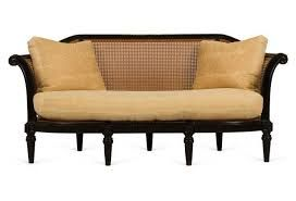 Crisp and comfortable with the elegance of a by-gone era. The caned back keeps it fresh. The details make it extraordinary. The Slocum Caned Sofa by Charles Fradin. www.charlesfradin.com