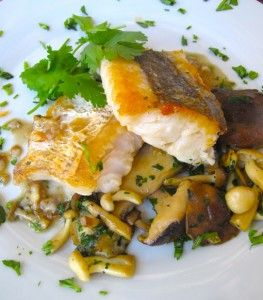 Sesame-fried hake with exotic mushrooms