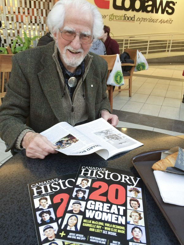 Hans Blohm browsing the issue of Canada's History magazine with the article on Abraham Ulrikab.