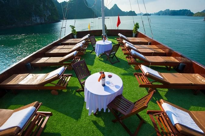 Halong Bay Overnight Cruise from Hanoi Experience Halong Bay in more than just one day on an overnight boat trip with transport from Hanoi. This 3-star cruise features modern comforts and international standards while maintaining traditional style and ambience. Safety is the priority while impeccable service is a key feature. The eight deluxe cabins include ensuite bathrooms, fine furniture, and views of the UNESCO-listed bay. Meals are provided in the dining room, where you c...