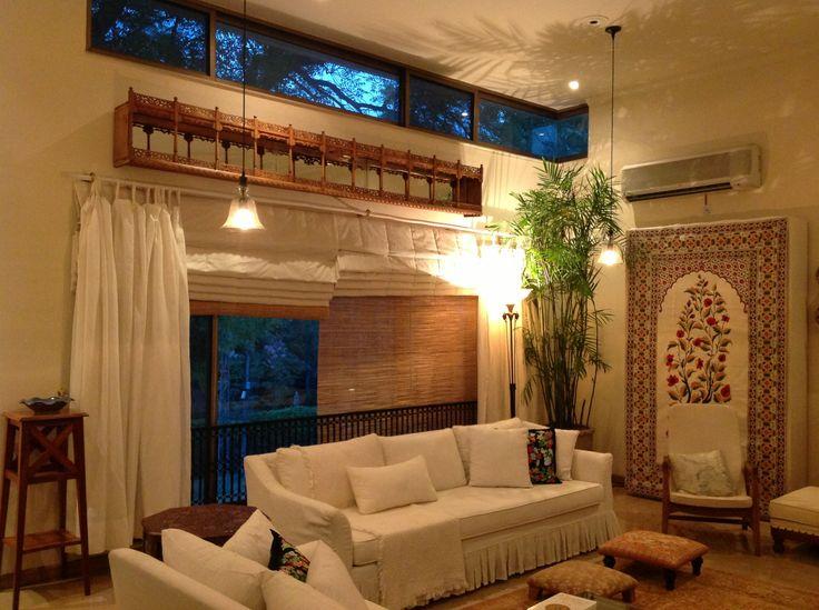 White sofa and printed bookshelf curtain