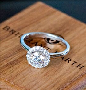 Brilliant Earth engagement ring. Rule of thumb the diamond needs to be twice the with of the band before you add the halo.