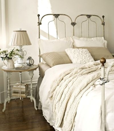I love the textures abd layers of white bedding.